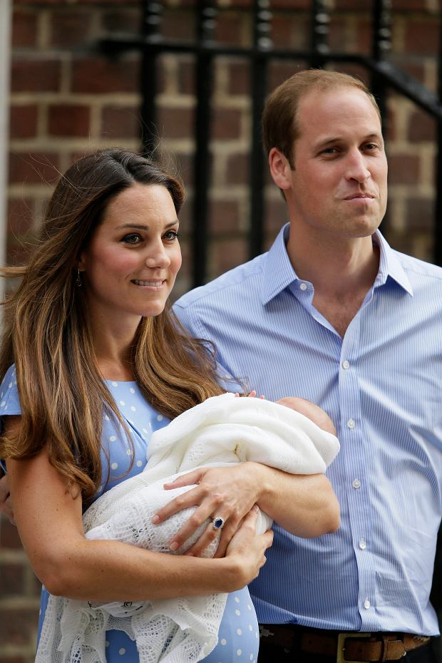 Britain's Prince William, right, and Kate, Duchess of Cambridge hold the Prince of Cambridge, Tuesday July 23, 2013, as they pose for photographers outside St. Mary's Hospital exclusive Lindo Wing in London where the Duchess gave birth on Monday July 22. The Royal couple are expected to head to London?s Kensington Palace from the hospital with their newly born son, the third in line to the British throne. (AP Photo/Alastair Grant)