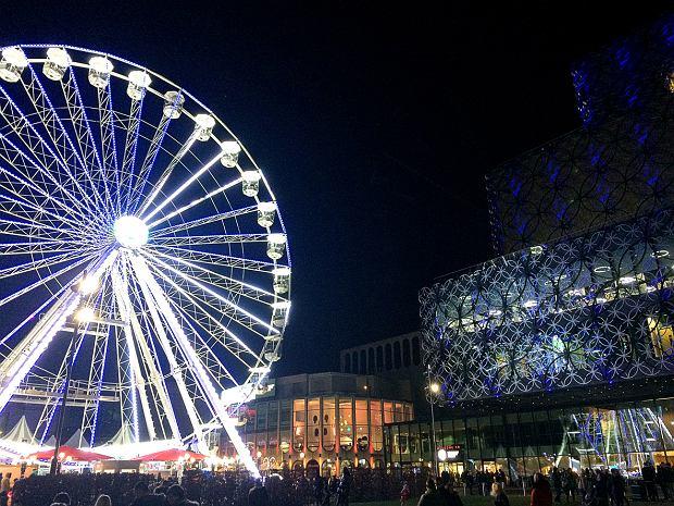 Birmingham, United Kingdom - December 3, 2016: Big Wheel, Birmingham. People enjoying the event in front of the Library of Birmingham.