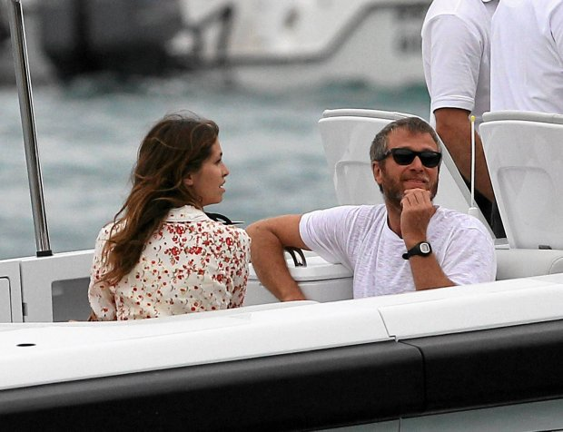 Roman Abramovich and girlfriend Daria Zhukova get on a dinghy boat to their gigantic yacht in St Barts. The couple had Hermes bags in their hands as they got on with friends. Roman Abramovich will be throwing a lavish New Years Eve party in St Barts.  Pictured: Roman Abramovich and girlfriend Daria Zhukova SLOWA KLUCZOWE: NEWS TO IN THE OFF THEY BY ON A AND FROM NEW YORK LOS ANGELES WITH LONDON WILL BE THEIR PARTY FUN GIRLFRIEND YACHT IT YEARS PICTURE WHITE ALL AWAY AS FRIENDS HAD WATER BREAK ST TIME COUPLE ROMAN EVE ZHUKOVA GOOD TAKING HANDS BOAT GET BEARD HAIR HOLIDAY GETTING PICTURES VACATION SUNGLASSES PICTURED TEE GOT T-SHIRT SHIRT HAVING SPLASH RECREATION DUTY DINGHY BAGS RELAXATION HERMES LAVISH THROWING RELAXING FACIAL ABRAMOVICH GIGANTIC BOATING DARIA T BARTS PHOTODESK