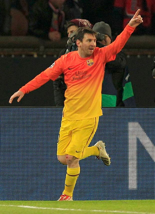 Barcelona's Lionnel Messi celebrates after scoring goal against Paris St Germain during their Champions League quarter-final first leg soccer match at the Parc des Princes Stadium in Paris, April 2, 2013.     REUTERS/Gonzalo Fuentes (FRANCE  - Tags: SPORT SOCCER)
