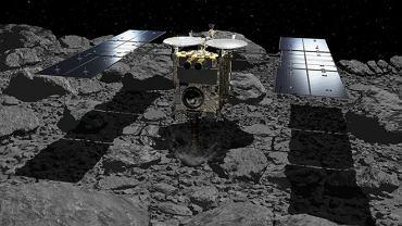Hayabusa ląduje na powierzchni planetoidy (asteroidy) Ryugu. Wizja artysty
