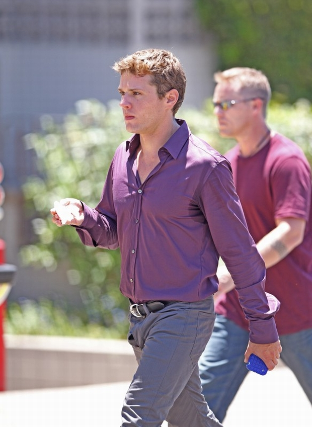 "July 13th, 2010  Los Angeles, CA. ***EXCLUSIVE*** Ryan Phillippe arrives on to the set with of ""The Lincoln Lawyer"" with what appears to be a wardrobe malfunction with the fly of Phillippe's pants which kept flapping open as he walked. Wardrobe department personnel were later seen adjusting Ryan's trousers before he filmed a scene inside an apartment building. Ryan Phillippe co stars with Matthew McConaughey in ""The Lincoln Lawyer"" about a lawyer who conducts business from the back of his Lincoln town car .Photo by Eric Ford/On Location News 818-613-3955 info@onlocationnews.com"