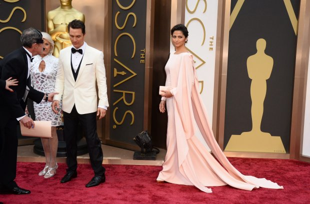 Matthew McConaughey, left, and Camila Alves arrive at the Oscars on Sunday, March 2, 2014, at the Dolby Theatre in Los Angeles.  (Photo by Jordan Strauss/Invision/AP)