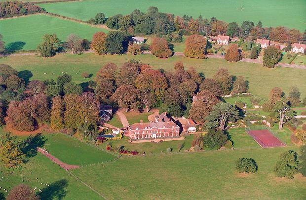 Photo Must Be Credited ?Alpha Press 028827 23/10/1997 Anmer Hall on the Sandringham Estate Norfolk . Plans unveiled for Kate and William's future Sandringham home. With a baby on the way, it is the perfect royal retreat - large, leafy and discreet. This is the Norfolk bolthole reportedly earmarked for parents-to-be the Duke and Duchess of Cambridge, just a stone?s throw from the Queen?s own private residence at Sandringham. These include a new garden room and a pergola made from stone columns with oak beams for plants to trail through, providing both shade and privacy on the patio area. More importantly, however, King?s Lynn and West Norfolk Borough Council have also given the Queen, who is the Georgian mansion?s landlord, approval to re-route its existing driveway and plant dozens of new trees and shrubs to shield it from prying eyes. The ten-bedroom property is one of 150 situated on the monarch?s 20,000-acre Sandringham Estate in Norfolk and is only two miles east of Sandringham House, one of her favourite private residences. The hall, which largely dates back to 1802, was used as an illicit bolt-hole by Prince Charles and the then Camilla Parker-Bowles during their long-running affair when it was rented by the prince?s friend Hugh van Cutsem. Council officers approved the plans under delegated powers, which means they did not have to go through the usual council planning process. According to the application an existing wood store will be converted into extra accommodation - mostly likely for police officers guarding the property - while a garage block will be transformed into an equipment room. Other plans involve moving the main gates to the property further down a lane so members of the public will not be able to get so close to the house. The new, longer private driveway will sweep across an existing field, currently used as grazing land, before reaching the front of the house, which has its own swimming pool and tennis court. A new gate will be built across what is currently a public road and a lawn taken out to create extra parking space. The current public entrance to nearby St Mary?s Church will become accessible only to the Duke and Duchess, with the approach road re-routed to create a new entrance for worshippers. To compensate them the Queen will pay for a new car park to be built.