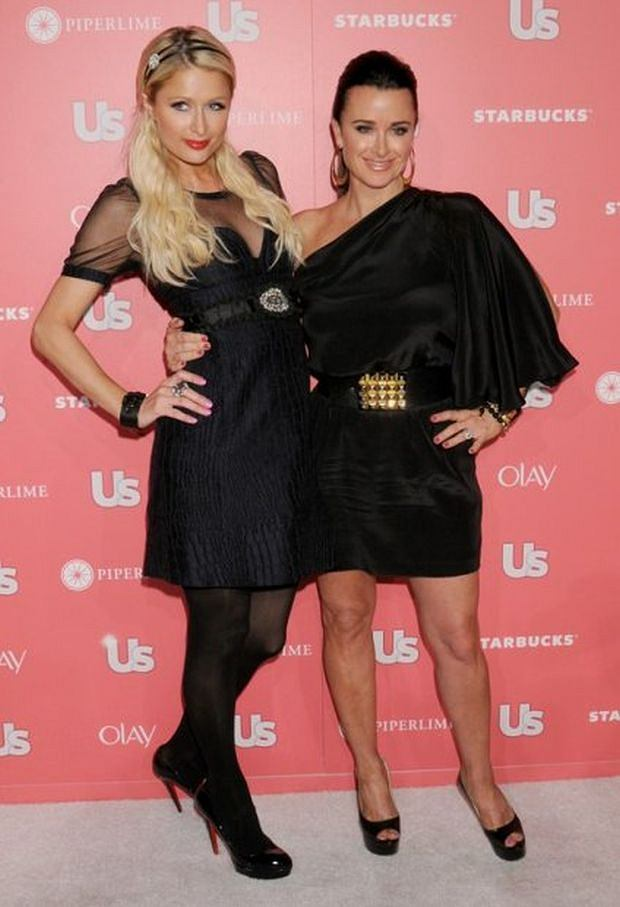HOLLYWOOD, CA - APRIL 26: Kyle Richards and Paris Hilton arrive at the US Weekly Annual Hot Hollywood Style Issue Party Celebrating 2011 Style Winners at Eden on April 26, 2011 in Hollywood, California. (Photo by Gregg DeGuire/PictureGroup)
