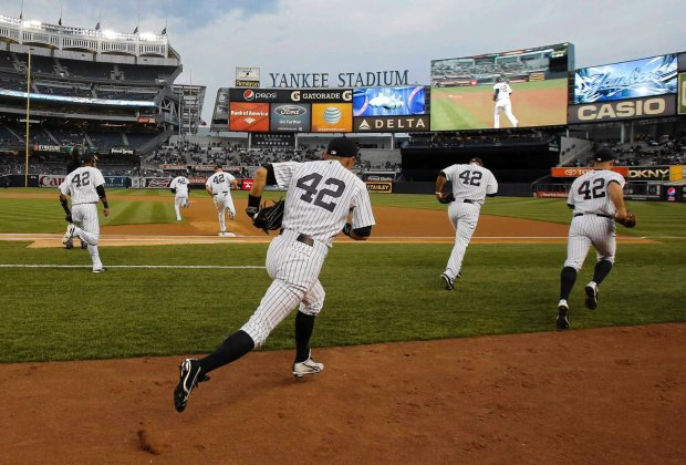RNPS - PICTURES OF THE YEAR 2013 - New York Yankees take the field before their MLB Interleague game with the Arizona Diamondbacks at Yankee Stadium in New York April 16, 2013. Players are all wearing the number 42 in honor of Hall of Fame player Jackie Robinson. Right fielder Ichiro Suzuki is in the foreground. REUTERS/Ray Stubblebine (UNITED STATES - Tags: SPORT BASEBALL TPX)