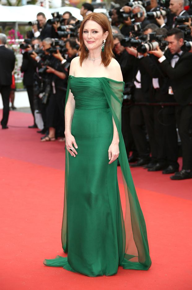 Actress Julianne Moore poses for photographers upon arrival at the opening ceremony and the premiere of the film