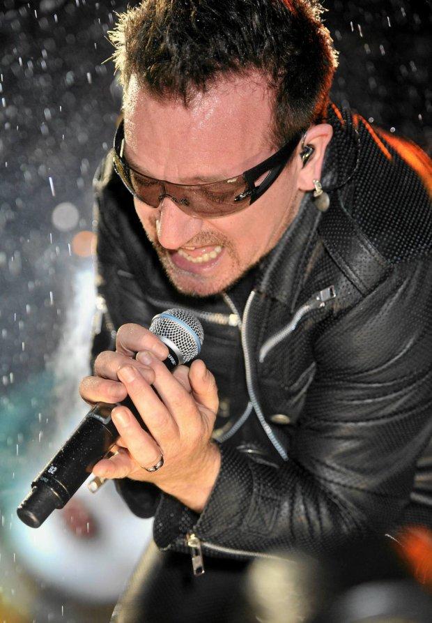 Irish band U2's singer Bono performs on the main stage at Glastonbury Festival on Friday June 24, 2011. (AP Photo/Mark Allan)