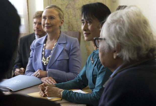 Myanmar's pro-democracy opposition leader Aung San Suu Kyi, second right, and U.S. Secretary of State Hillary Rodham Clinton, third right,   talk during a meeting in Suu Kyi's residence in Yangon, Myanmar Friday, Dec. 2, 2011.  U.S. Secretary of State Clinton and Myanmar opposition leader Suu Kyi, two of the world's most recognizable female leaders, pledged Friday to work together to bring democracy to Suu Kyi's long isolated and repressive nation.  (AP Photo/Saul Loeb, Pool)
