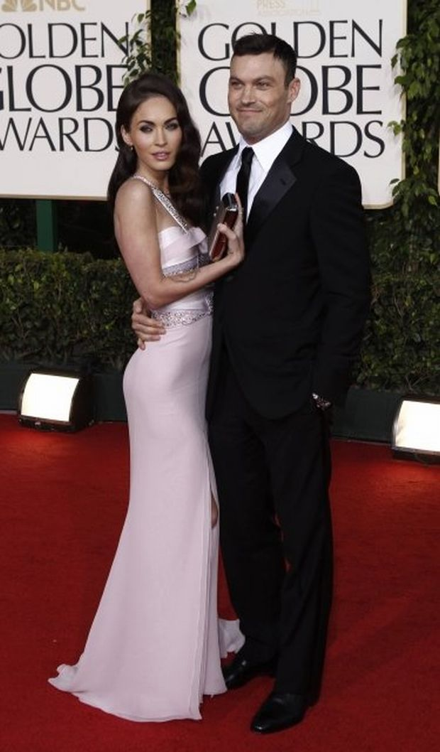 Actors Megan Fox and Brian Austin Green arrives at the Golden Globe Awards Sunday, Jan. 16, 2011, in Beverly Hills, Calif. (AP Photo/Matt Sayles)