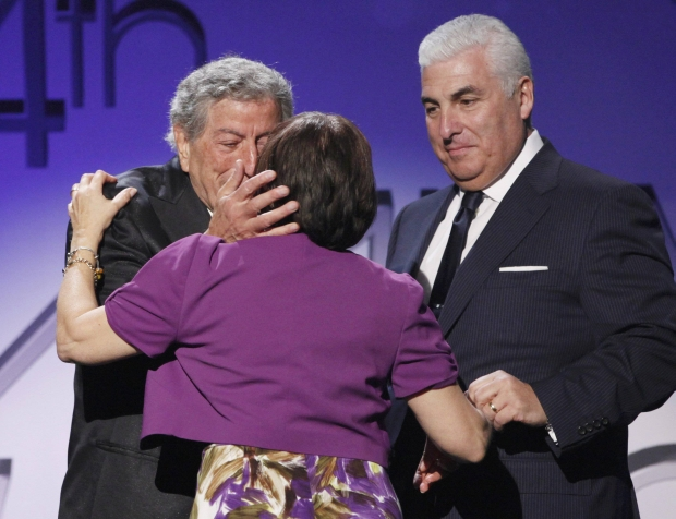 "Janis Winehouse is kissed by singer Tony Bennett (L) as she and her husband Mitch, parents of late singer Amy Winehouse, come up on stage after Bennet and their daughter won ""Pop Duo/Group Performance"" (Body And Soul) at the 54th annual Grammy Awards in Los Angeles, California February 12, 2012.   REUTERS/Mario Anzuoni   (UNITED STATES)  (GRAMMYS-SHOW)"