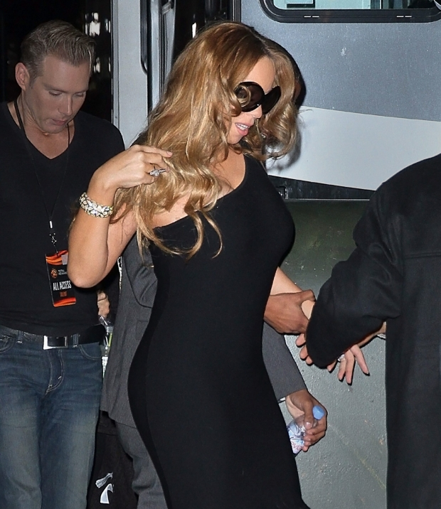 ??NATIONAL PHOTO GROUP   A svelte Mariah Carey walks hand-in-hand with Nick Cannon to Gotham Hall for a performance in NYC.  Job: 030112M6  .  March 1st, 2012 New York, NY  NPG.com