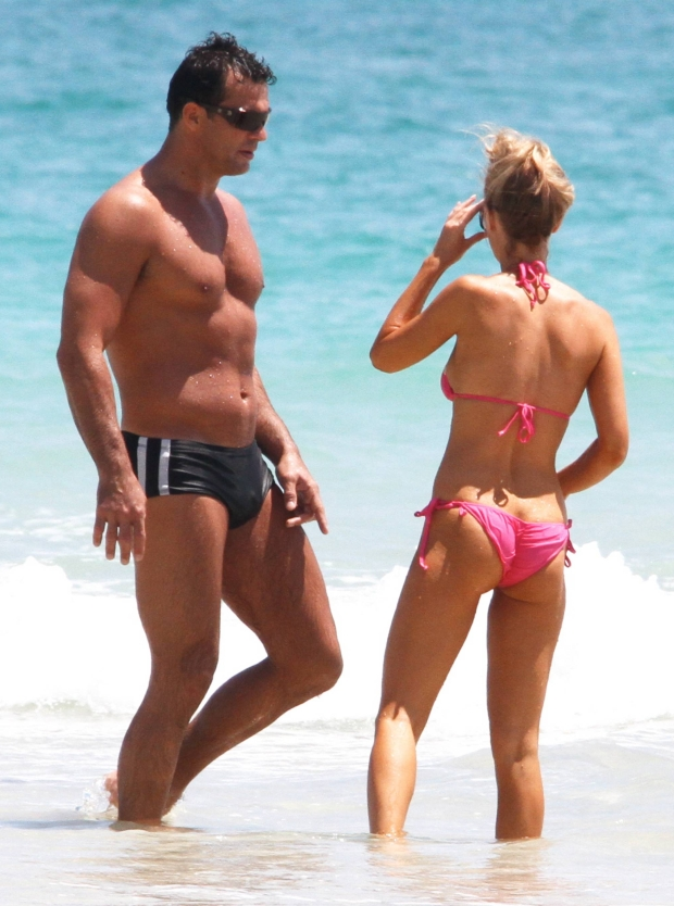 MAVRIXONLINE.COM - NO WEB/APPS/MOBILE UNLESS FEES AGREED - EXCLUSIVE!! Joanna Krupa spends a day at the beach with her buff fianc? Romain Zago. The Polish born blonde beauty wore a pink bikini that showed off her famous model curves. Krupa, a one-time Dancing With the Stars alum, is currently starring on The Real Housewives of Miami.Miami Beach, FL. 20th April 2012  Fees must be agreed prior to publication.  Byline, credit, TV usage, web usage or linkback must read MAVRIXONLINE.COM.  Failure to byline correctly will incur double the agreed fee.  Tel: +1 305 542 9275.