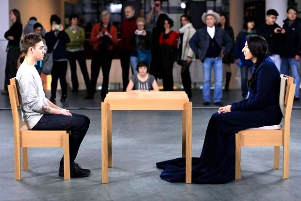 Marina Abramovic, right, and a visitor to the Museum of Modern art perform