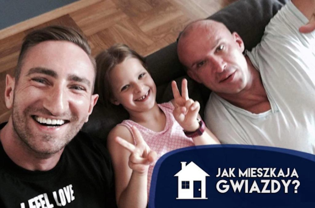 Łukasz Jakóbiak i Tomasz Oświęciński z córką Mają