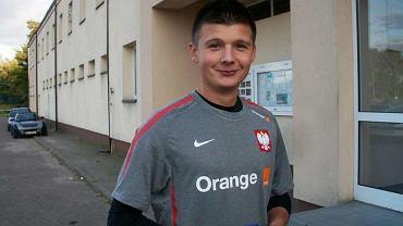 Marcin Marcinkowski w stroju reprezentacji Polski.