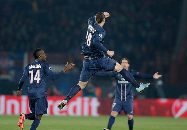 Paris St Germain's Zlatan Ibrahimovic (C) jumps high as he celebrates with Blaise Matuidi (L) after scoring against Barcelona during their Champions League quarter-final first leg soccer match at the Parc des Princes Stadium in Paris, April 2, 2013.        REUTERS/Christian Hartmann (FRANCE  - Tags: SPORT SOCCER TPX IMAGES OF THE DAY)