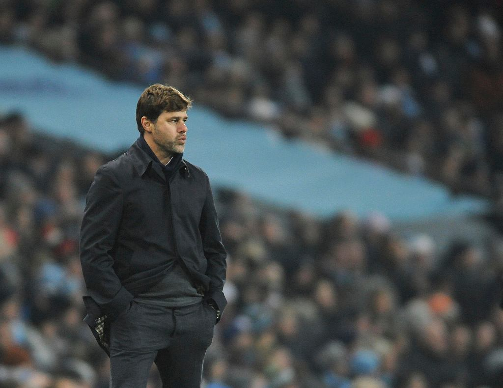 Tottenham's manager Mauricio Pochettino stands on the sideline during the English Premier League soccer match between Manchester City and Tottenham Hotspur at Etihad stadium, in Manchester, England, Saturday, Dec. 16, 2017. (AP Photo/Rui Vieira)