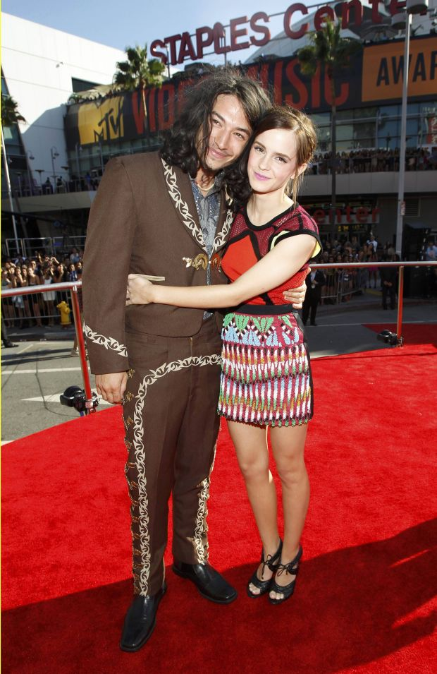 Actress Emma Watson with actor Ezra Miller   at the 2012 MTV Video Music Awards in Los Angeles, September 6, 2012.  REUTERS/Mario Anzuoni    (UNITED STATES  - Tags: ENTERTAINMENT)  (MTV-ARRIVALS)