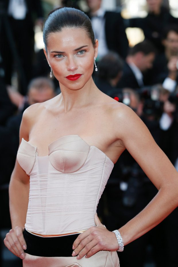 Model Adriana Lima poses for photographers as she arrives for the screening of The Homesman at the 67th international film festival, Cannes, southern France, Sunday, May 18, 2014. (AP Photo/Alastair Grant)