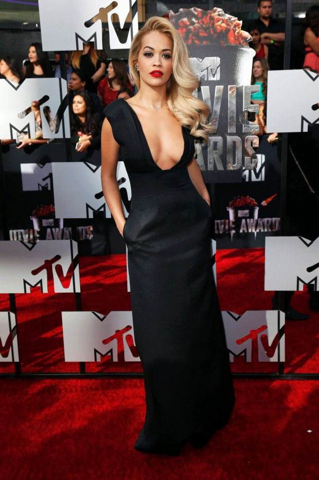 Singer Rita Ora arrives at the 2014 MTV Movie Awards in Los Angeles, California April 13, 2014.  REUTERS/Danny Moloshok  (UNITED STATES - Tags: Entertainment) (MTV-ARRIVALS)