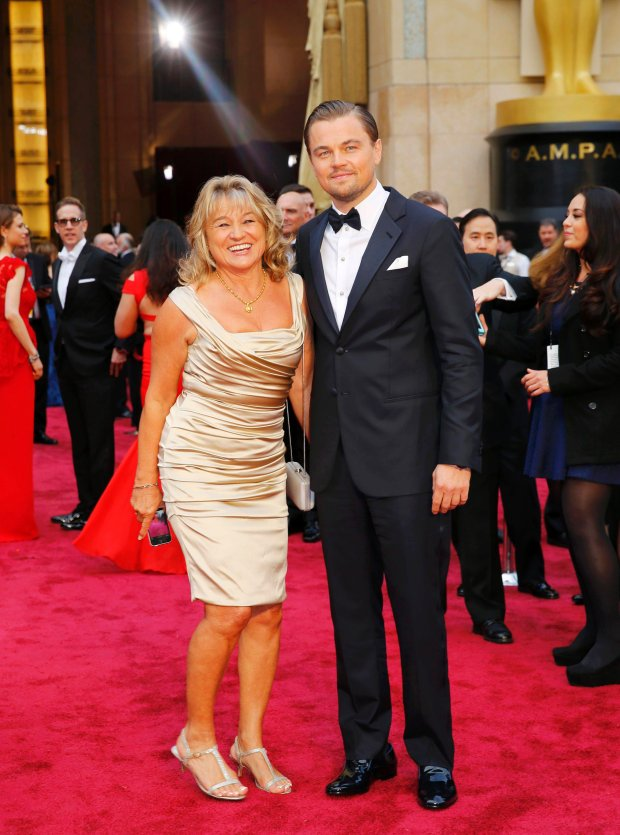 "Leonardo DiCaprio, best actor nominee for his role in ""The Wolf of Wall Street"", and his mother Irmelin DiCaprio arrive on the red carpet at the 86th Academy Awards in Hollywood, California March 2, 2014.  REUTERS/Mike Blake (UNITED STATES TAGS: ENTERTAINMENT) (OSCARS-ARRIVALS)"