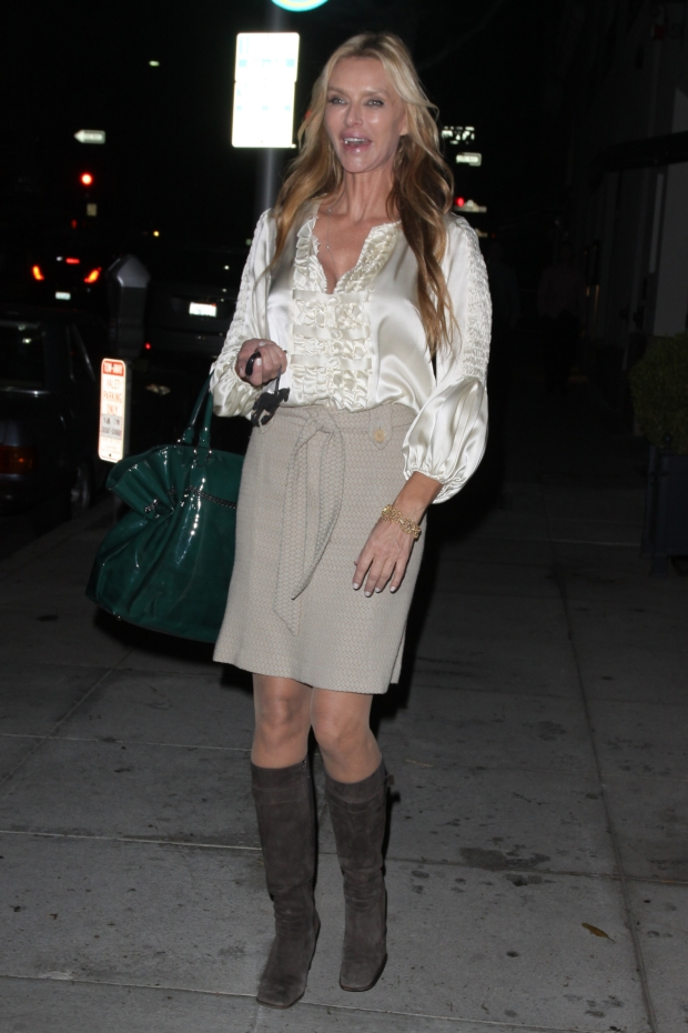 *EXCLUSIVE* Beverly Hills, CA - Blonde beauty Kimberley Conrad out for a bite to eat at Mr Chow in Beverly Hills.  The former Mrs Hugh Hefner was looking youthful in a white blouse, gray mini skirt, green purse and brown suede boots.      AKM-GSI          October 9, 2012    To License These Photos, Please Contact :    Steve Ginsburg  (310) 505-8447  (323) 4239397  steve@ginsburgspalyinc.com  sales@ginsburgspalyinc.com    or    Keith Stockwell  (310) 261-8649  (323) 325-8055   keith@ginsburgspalyinc.com  ginsburgspalyinc@gmail.com *** Local Caption ***  Kimberley Conrad