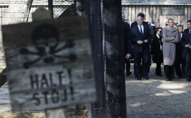 Monaco's Prince Albert (3rd R) and Princess Charlene visit the former Nazi death camp of Auschwitz in Oswiecim October 19, 2012. REUTERS/Kacper Pempel (POLAND - Tags: ROYALS SOCIETY)