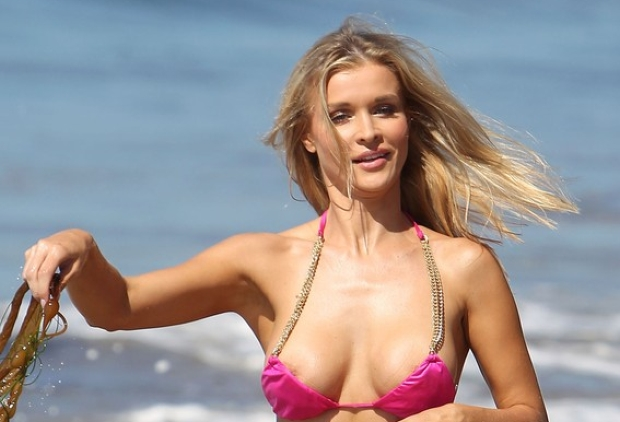 82033, LOS ANGELES, CALIFORNIA - Tuesday August 7, 2012. **EXCLUSIVE** Polish model Joanna Krupa enjoys a day at the beach in Santa Monica with her sister Marta. The sexy blonde, who was recently announced as the newest cast mate on 'Real Housewives Of Miami,' rocked a tiny pink bikini as she frolicked on the beach and experienced a wardrobe malfunction as she briefly popped out of her top. The Krupa sisters, Marta is a model as well, played frisbee before catching some rays by laying out in the sun. **VIDEO AVAILABLE** Photograph: Jeff Steinberg, ? PacificCoastNews.com **FEE MUST BE AGREED PRIOR TO USAGE** **E-TABLET/IPAD & MOBILE PHONE APP PUBLISHING REQUIRES ADDITIONAL FEES** LOS ANGELES OFFICE:+1 310 822 0419 LONDON OFFICE:+44 20 8090 4079