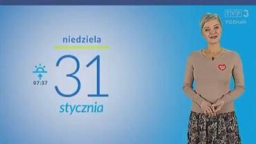 Prezenterka TVP podczas przedstawiania prognozy pogody z doklejonym do ubrania serduszkiem WOŚP