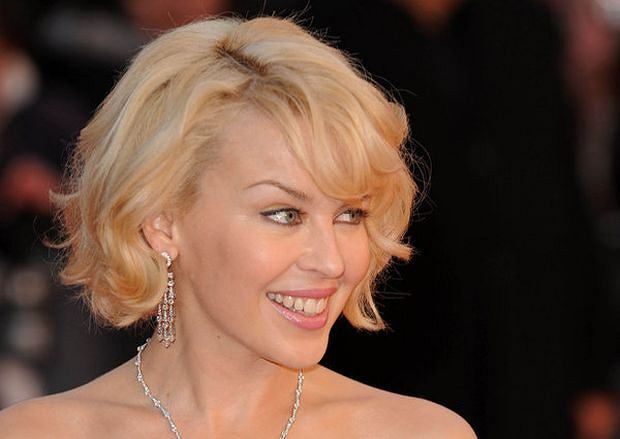 **ALL ROUND PICTURES FROM SOLARPIX.COM** **WORLDWIDE SYNDICATION RIGHTS** Red carpet arrivals at the Brit Awards 2008.  Held at Earls Court, London. UK. 20th February 2008  This pic: Kylie Minogue    JOB REF: 5825 SSD     DATE: 20_02_2008 **MUST CREDIT SOLARPIX.COM OR DOUBLE FEE WILL BE CHARGED* *UNDER NO CIRCUMSTANCES IS THIS IMAGE TO BE REPRODUCED FOR ANY ONLINE EDITION WITHOUT PRIOR PERMISSION*