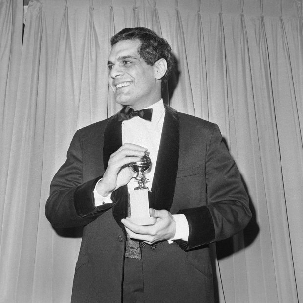 FILE - In this Jan. 31, 1966 file photo, actor Omar Sharif with his Golden Globe award for Best Actor for his role in Doctor Zhivago in Hollywood. Sharif has died in a Cairo hospital of a heart attack, his agent said on Friday, July 10, 2015.  (AP Photo/Harold P.Matosian, File )