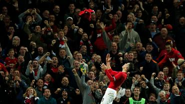 Manchester Uniteds Robin van Persie celebrates after scoring during their English Premier League soccer match against Chelsea at Old Trafford in Manchester