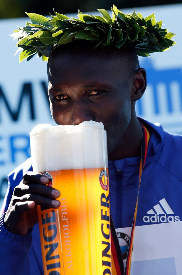 Winner Wilson Kipsang from Kenya drinks a beer during the victory ceremony for the 40th Berlin Marathon in Berlin, Germany, Sunday, Sept. 29, 2013. Kipsang set a new world record of 2h 3min 23sec. (AP Photo/Michael Sohn)