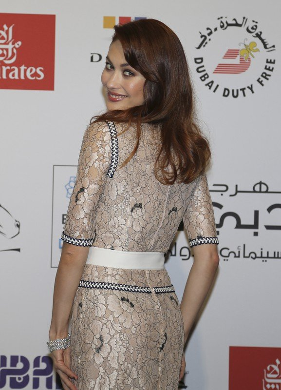 Actress Olga Kurylenko poses on the red carpet at the Water Diviner screening as part of the Dubai International Film Festival in Dubai, United Arab Emirates, Thursday, Dec. 11, 2014. (AP Photo/Kamran Jebreili)