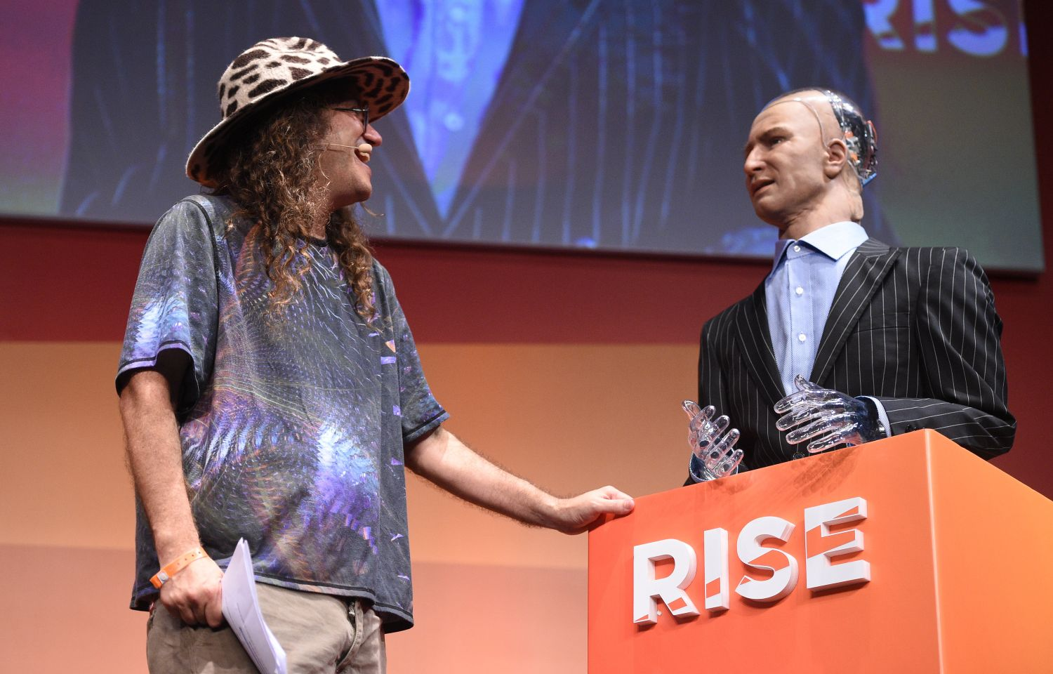 12 July 2017; Ben Goertzel, Chief Scientist, Hanson Robotics, with Han the Robot on Centre stage during day two of RISE 2017 in Hong Kong. Photo by Cody Glenn / RISE / Sportsfile