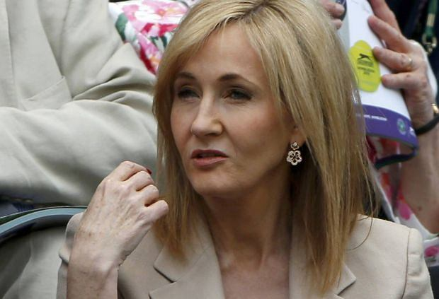 Author J K Rowling sits on Centre Court at the Wimbledon Tennis Championships, in London June 25, 2013.  REUTERS/Eddie Keogh (BRITAIN  - Tags: ENTERTAINMENT SOCIETY SPORT TENNIS)