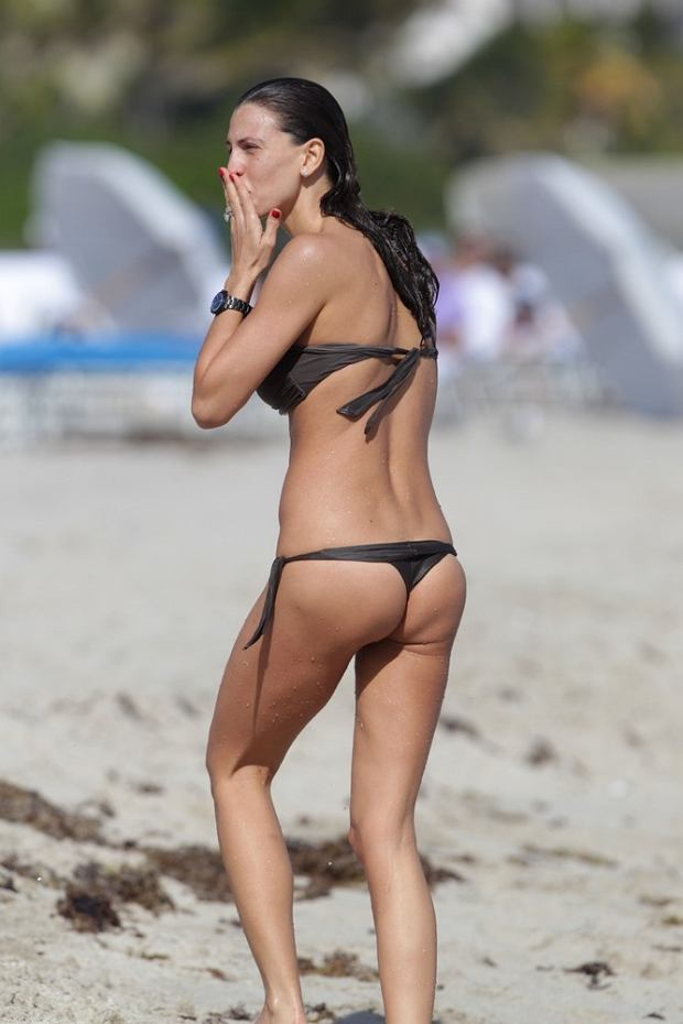 Italian-Paraguayan showgirl Claudia Galanti has a wardrobe malfunction on the beach in Miami. Claudia was spending the day sunbathing with her boyfriend Pietro Tavallini and friend Aida Yespica.  Pictured: Claudia Galanti