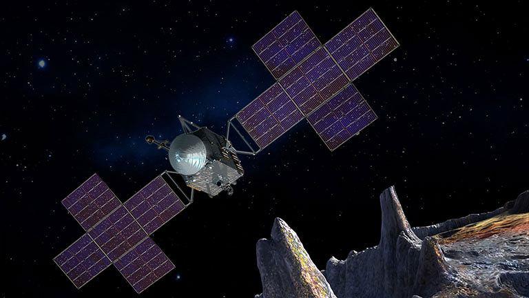 Statek kosmiczny zbliżający się do asteroidy Psyche - wizja artysty