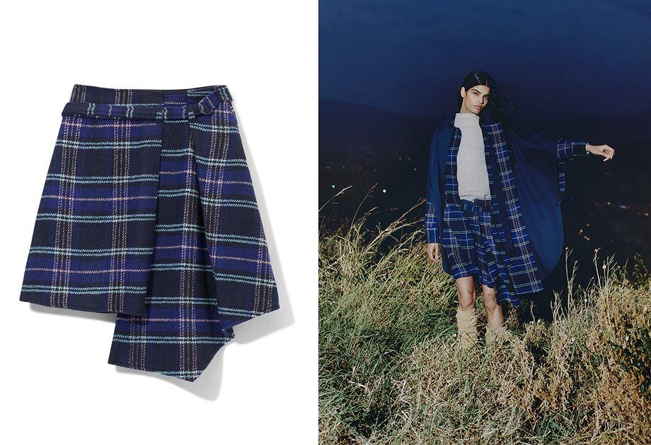 Spódnica w kratę nawiązuje do grunge'owego stylu z lat 90.