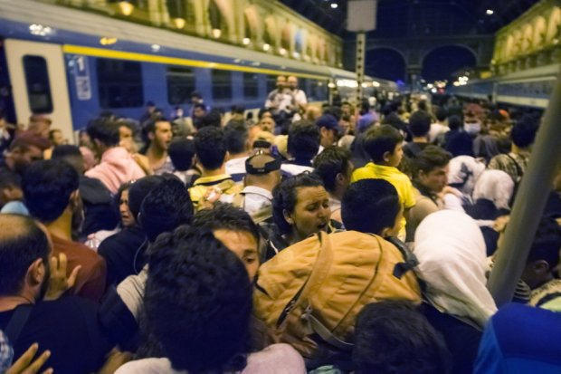 Migrants wait to board a train to Germany at the Keleti Railway Station in Budapest, Hungary, Tuesday, Sept, 1, 2015. (Zoltan Balogh/MTI via AP)