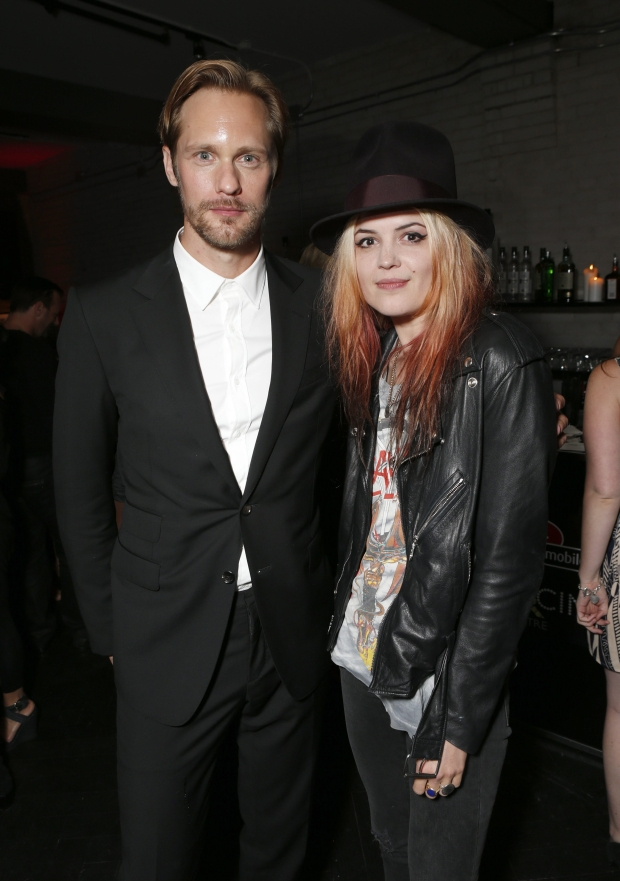 """Alexander Skarsgard and Alison Mosshart of The Kills attend the """"What Maisie Knew"""" After Party at Storys on Friday Sept 7, 2012, in Toronto. (Photo by Todd Williamson/Invision /AP Images)"""
