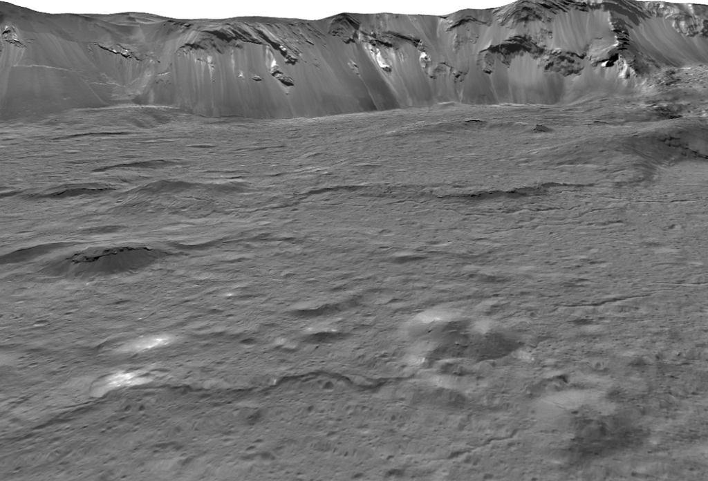 Powierzchnia planety karłowatej Ceres. Jasne punkty to pozostałość po słonej cieczy, która wydostała się na powierzchnię