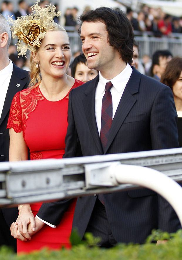 British actress Kate Winslet (L) and her boyfriend Ned Rocknroll attend a promotional event for the Hong Kong international races in Hong Kong December 9, 2012. REUTERS/Tyrone Siu (CHINA - Tags: ENTERTAINMENT SPORT HORSE RACING)