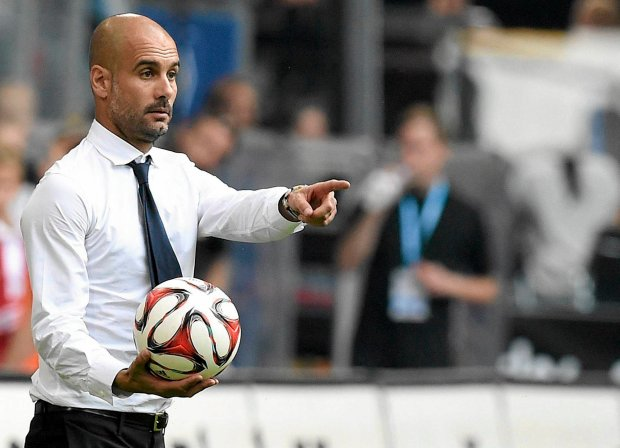 Bayern Munich's head coach Pep Guardiola holds the ball during their German Bundesliga first division soccer match against Hamburger SV in Hamburg, September 20, 2014.   REUTERS/Fabian Bimmer (GERMANY - Tags: SPORT SOCCER) DFL RULES TO LIMIT THE ONLINE USAGE DURING MATCH TIME TO 15 PICTURES PER GAME. IMAGE SEQUENCES TO SIMULATE VIDEO IS NOT ALLOWED AT ANY TIME. FOR FURTHER QUERIES PLEASE CONTACT DFL DIRECTLY AT + 49 69 650050