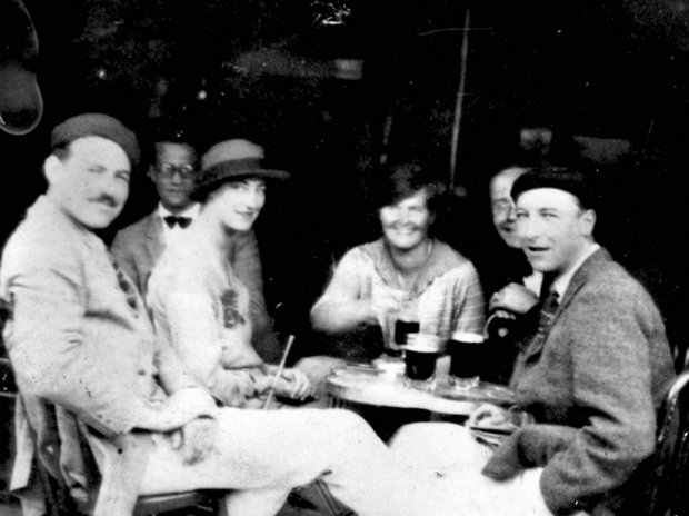EH 5734P  Ernest Hemingway with Lady Duff Twysden, Hadley Hemingway, and three unidentified people at a cafe in Pamplona, Spain, during the Fiesta of San Fermin in July 1925.  Photograph in the Ernest Hemingway Photograph Collection, John F. Kennedy Presidential Library and Museum, Boston. SLOWA KLUCZOWE: Ernest Hemingway American writer author EH family wife Hadley Hemingway Lady Duff Twysden cafe table Pamplona Spain Fiesta of San Fermin
