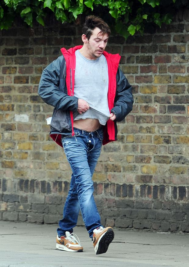 15 MAY 2015  - LONDON  - UK  *** EXCLUSIVE PICTURES ***  IRISH ACTOR JONATHAN RHYS MEYERS LOOKIN WORSE FOR WEAR AS HE TRIES TO GET TWO BOTTLES OF VODKA IN ONE SHOP WHERE THEY REFUSE TO SERVE HIM BUT SECOND TIME ROUND HE MANAGED TO GET HIS VODKA. HE COULDNT WAIT TO GET HOME TO DRINK IT SO STARTED DRINKING IN THE STREET!!!  BYLINE MUST READ : XPOSUREPHOTOS.COM  ***UK CLIENTS - PICTURES CONTAINING CHILDREN PLEASE PIXELATE FACE PRIOR TO PUBLICATION ***  **UK CLIENTS MUST CALL PRIOR TO TV OR ONLINE USAGE PLEASE TELEPHONE  442083442007**