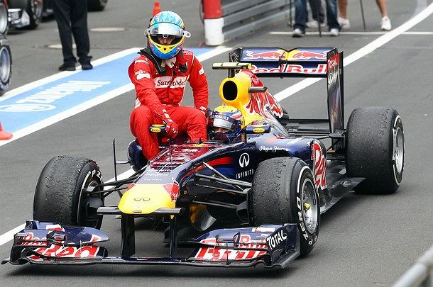 Fernando Alonso of Spain and Ferrari gets a lift back to the pits from Mark Webber of Australia and Red Bull Racing following the German Formula One Grand Prix at the Nurburgring on July 24, 2011 in Nuerburg, Germany. (Photo by Julian Finney/Getty Images)