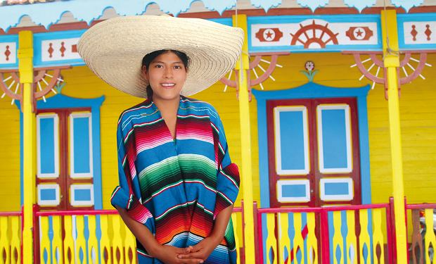 Latin mexican hispanic sombrero poncho woman colorful Mexico houses