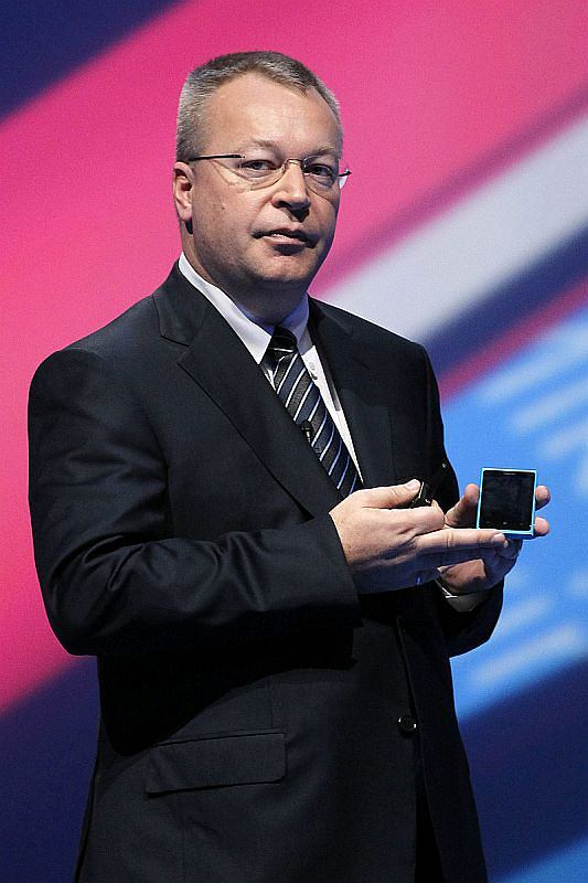 President and CEO of Nokia, Stephen Elop shows off the new Nokia Lumia 800 smartphone during the Nokia World 2011 at the ExCeL ICC center in London, Wednesday, Oct. 26, 2011. (AP Photo/Sang Tan)